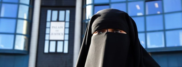 Hind Ahmas wears a niqab, despite a nationwide ban on the Islamic face veil, outside the courts in Meaux